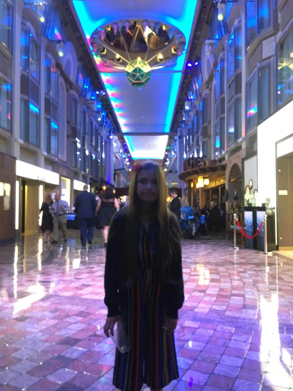 "Steve's daughter standing in the ""Royal Promenade"" on the Royal Caribbean Cruise ship."