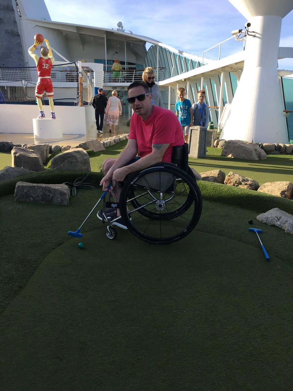 Steve enjoying a spot of mini golf on deck of the Royal Caribbean Cruise.