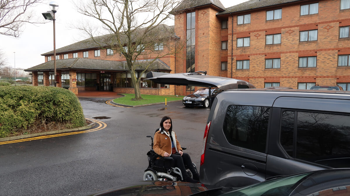 Emma about to go in her car which is parked in the hotels car park.