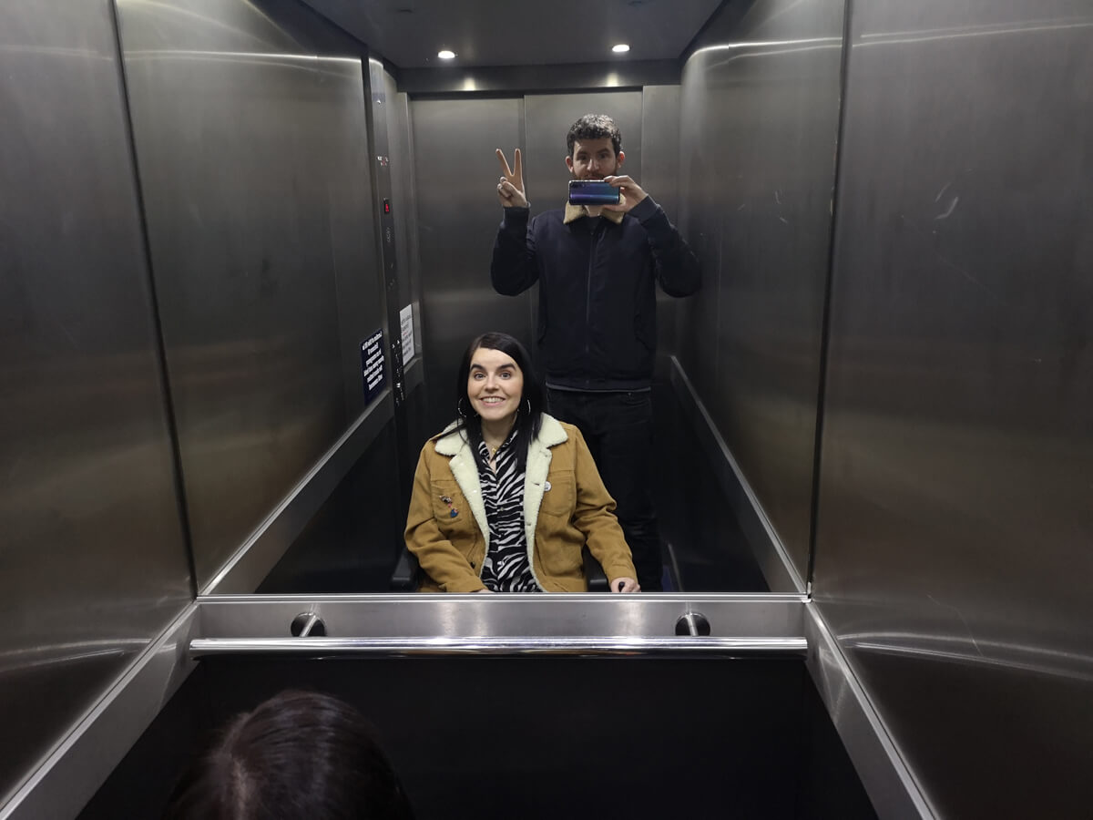 Emma and Allan inside the lift at FlyDSA Arena Sheffield.
