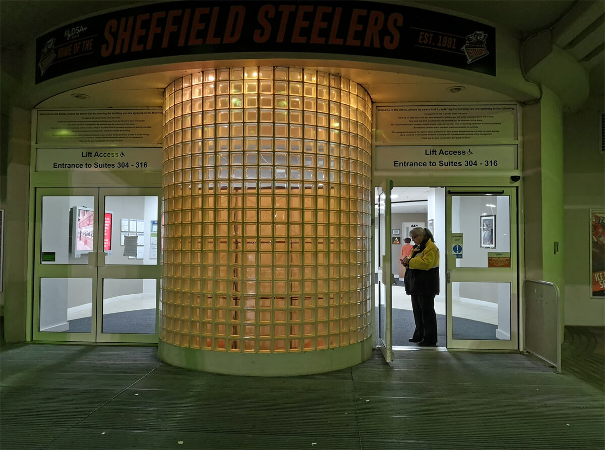 The accessible entrance of the FlyDS Arena Sheffield. A steward is standing in the doorway.