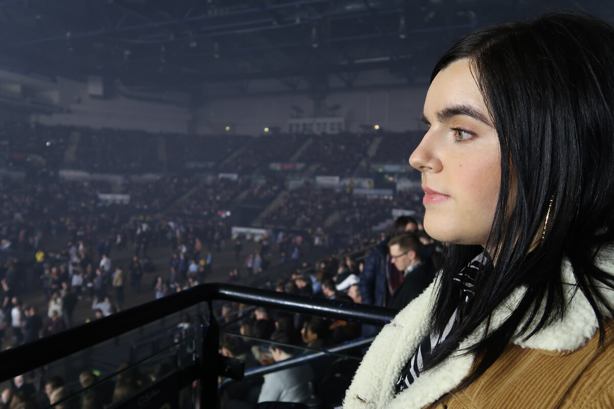 Emma sitting in the accessible seating bays looking towards the stage.