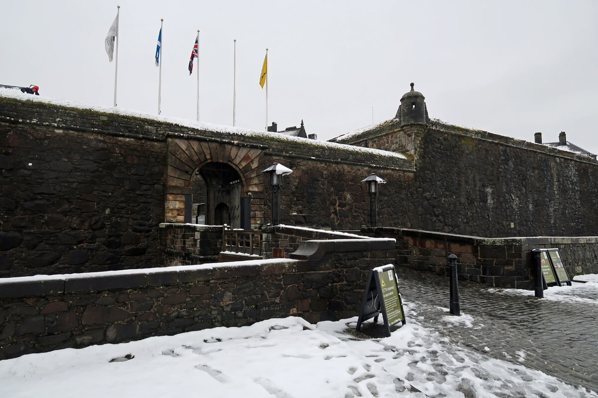 Stirling Castle entrance with snow covering the ground.