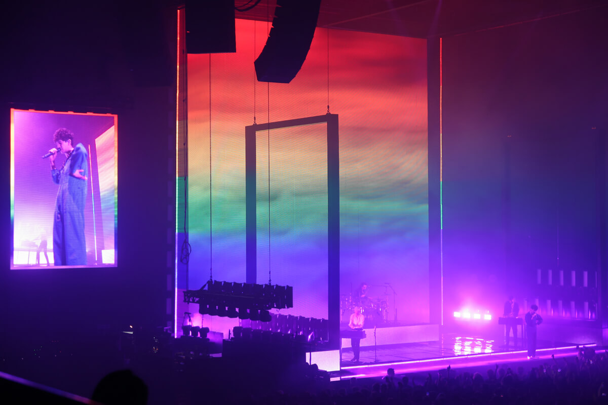 The 1975 performing on stage at FlyDSA Arena
