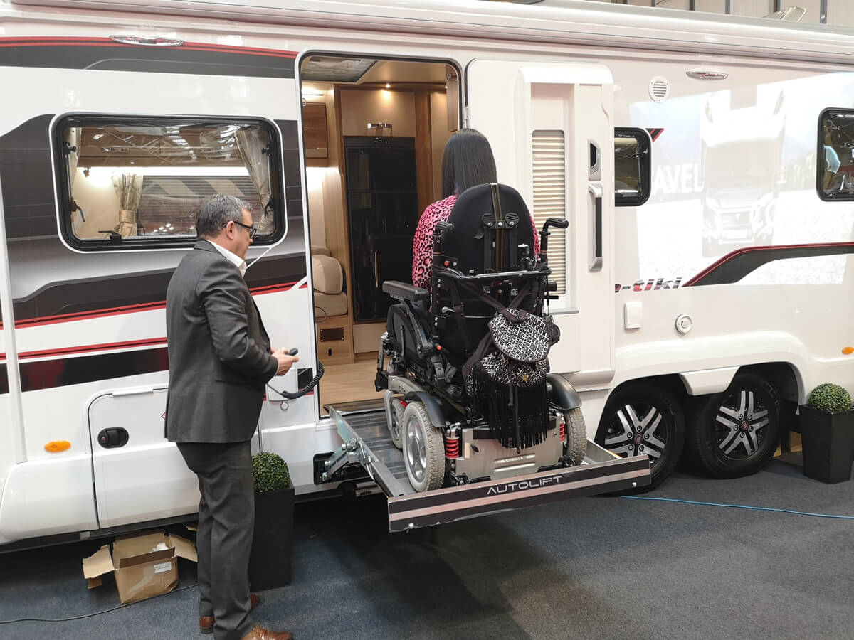 Emma on the electric lift accessing the Coachbuilt GB Wheelchair accessible motorhome