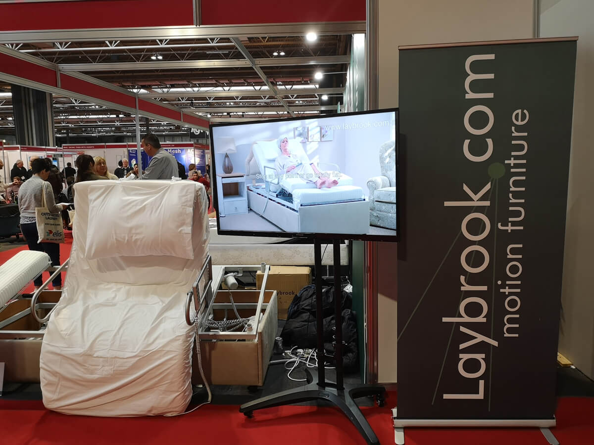 A carers height adjustable bed from Laybrooks at Naidex 45.