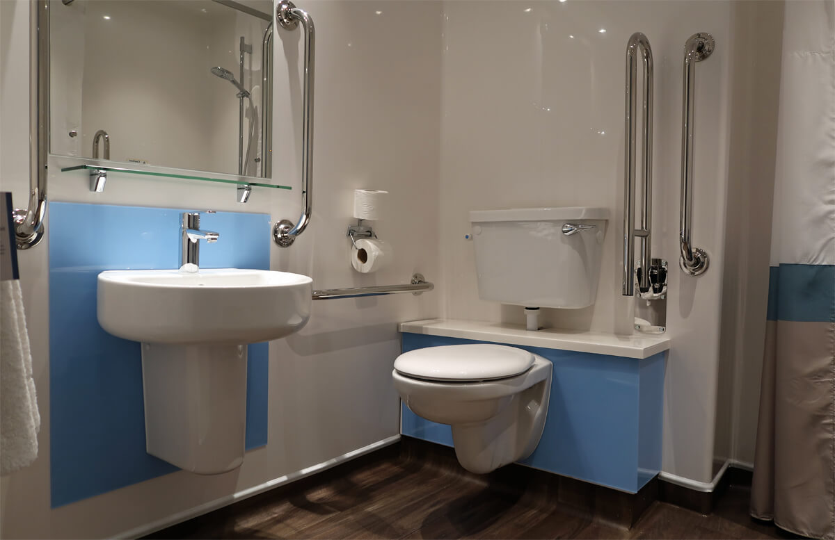 Travelodge Solihull wheelchair accessible SuperRoom bathroom toilet with grab bars.