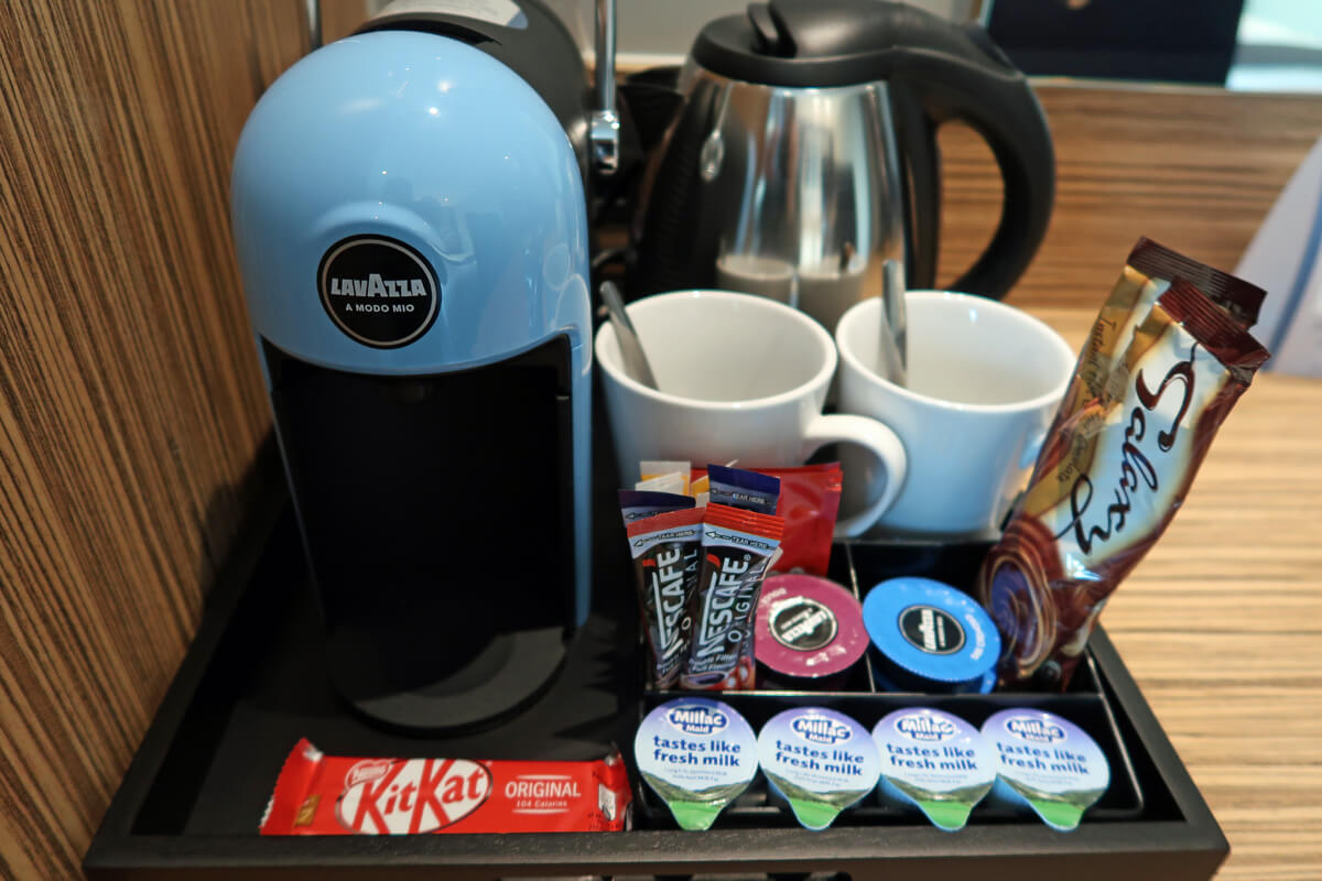 A close up shot of the Lavazza coffee machine in the Travelodge SuperRoom.