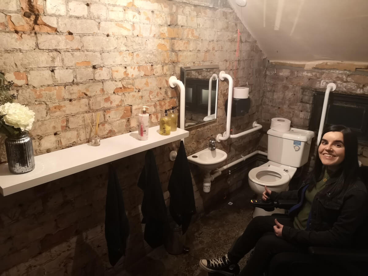 Emma in the accessible toilet at Albert Hall Manchester.