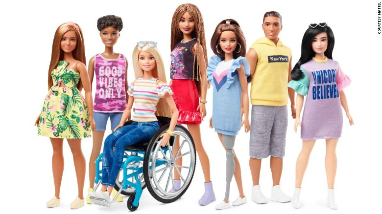 A range of Barbie dolls feautring wheelchair user Barbie and Barbie's of different shapes etc.