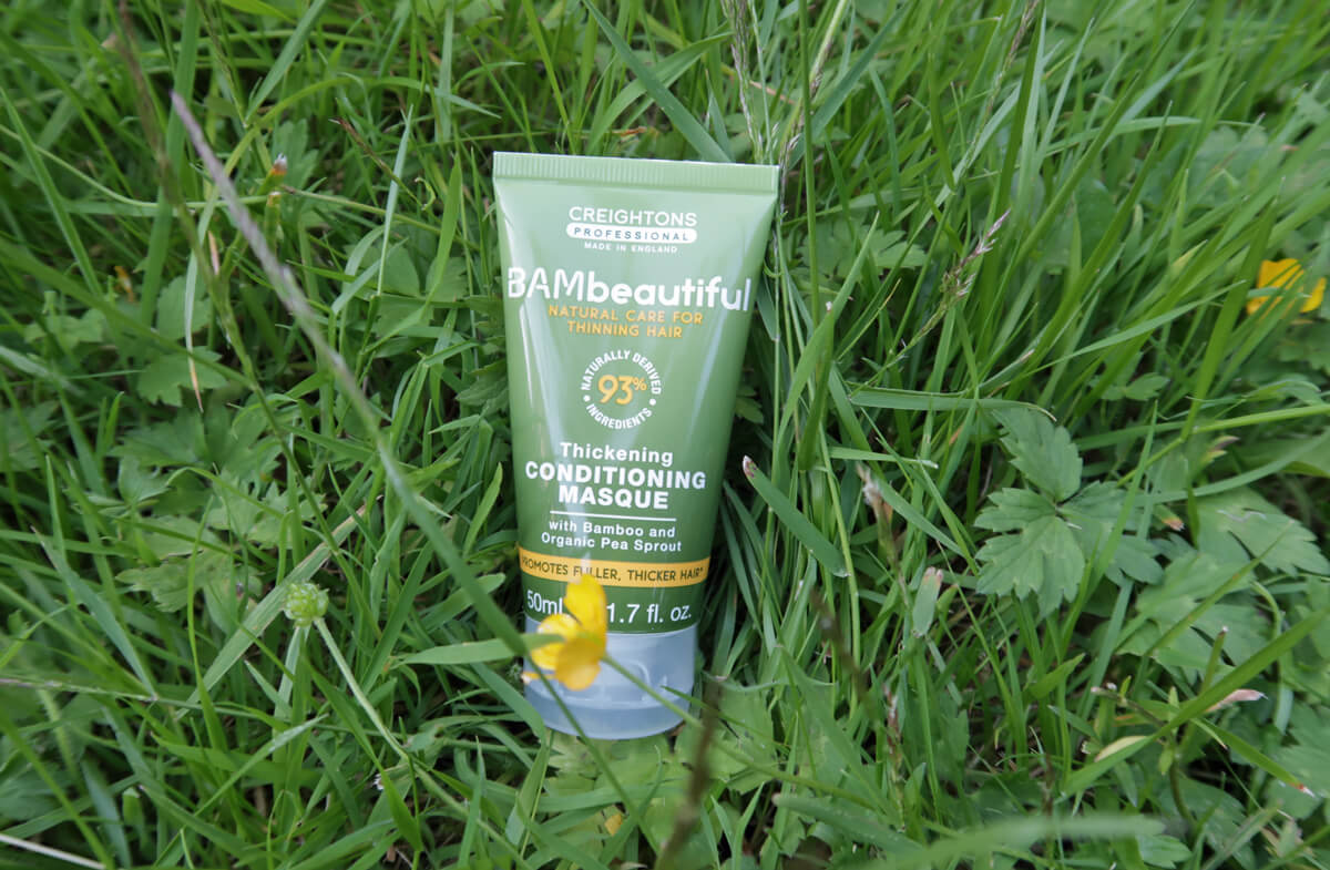 Creightons Professional BAMbeautiful Conditioning Masque placed on the grass.