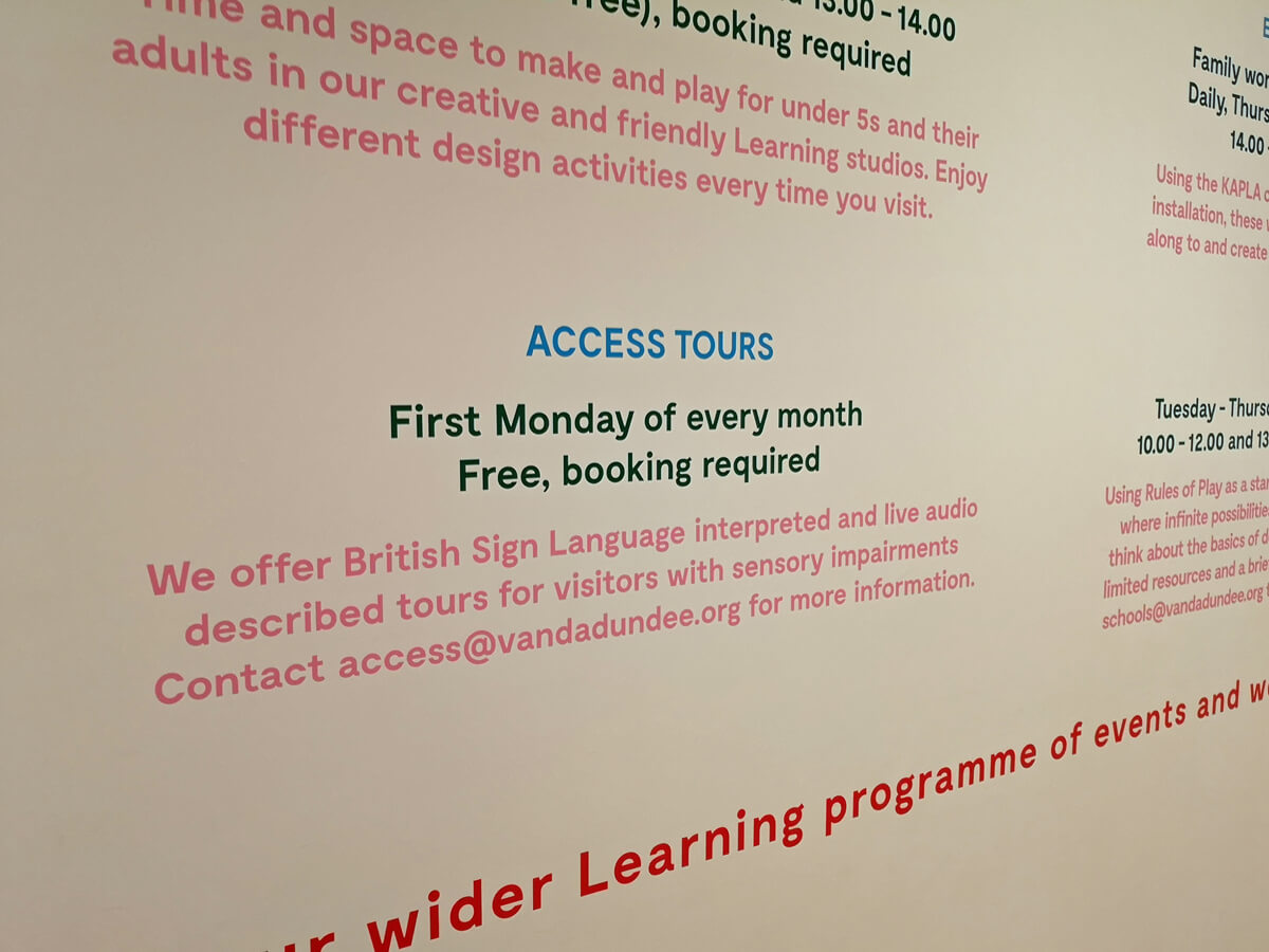 A close up of information detailing Access Tours on the wall at V&A Dundee.