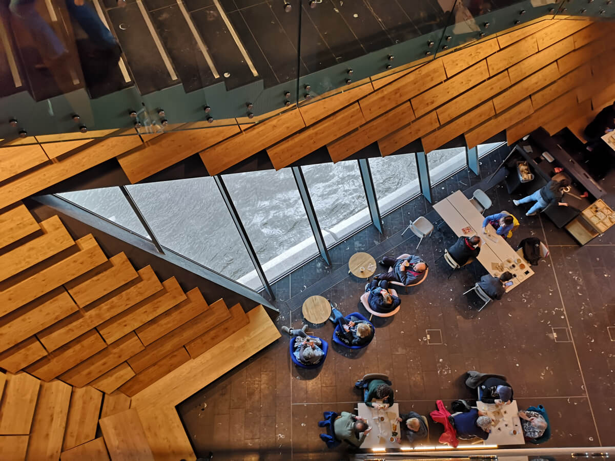 Looking down on V&A Dundee cafe from level 2.