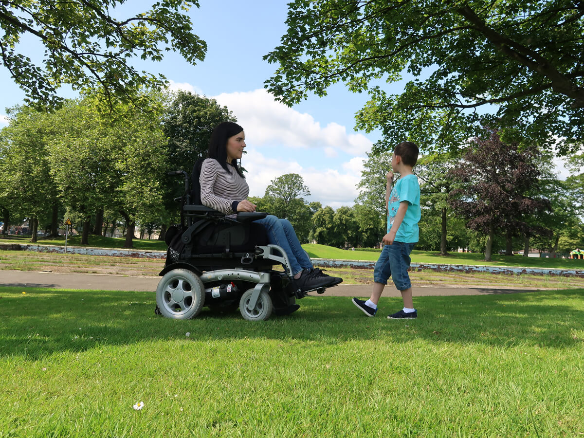 Emma and her nephew talking in the park.