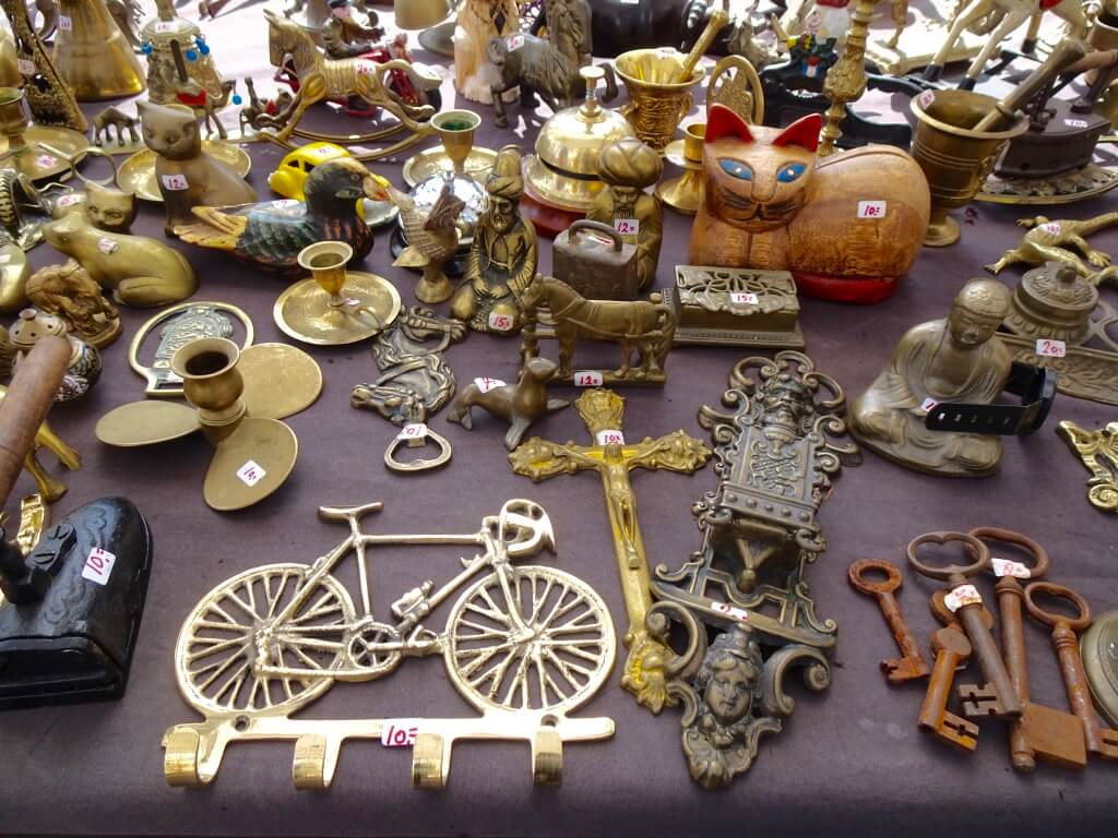 A collection of nick knacks on a table at the flea market.
