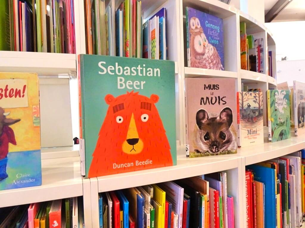 A collection of childrens book inside a library.
