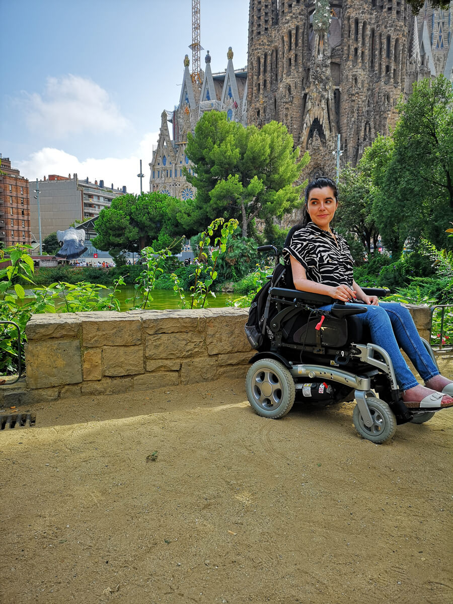 Emma sitting with the Sagrada Familia behind her.