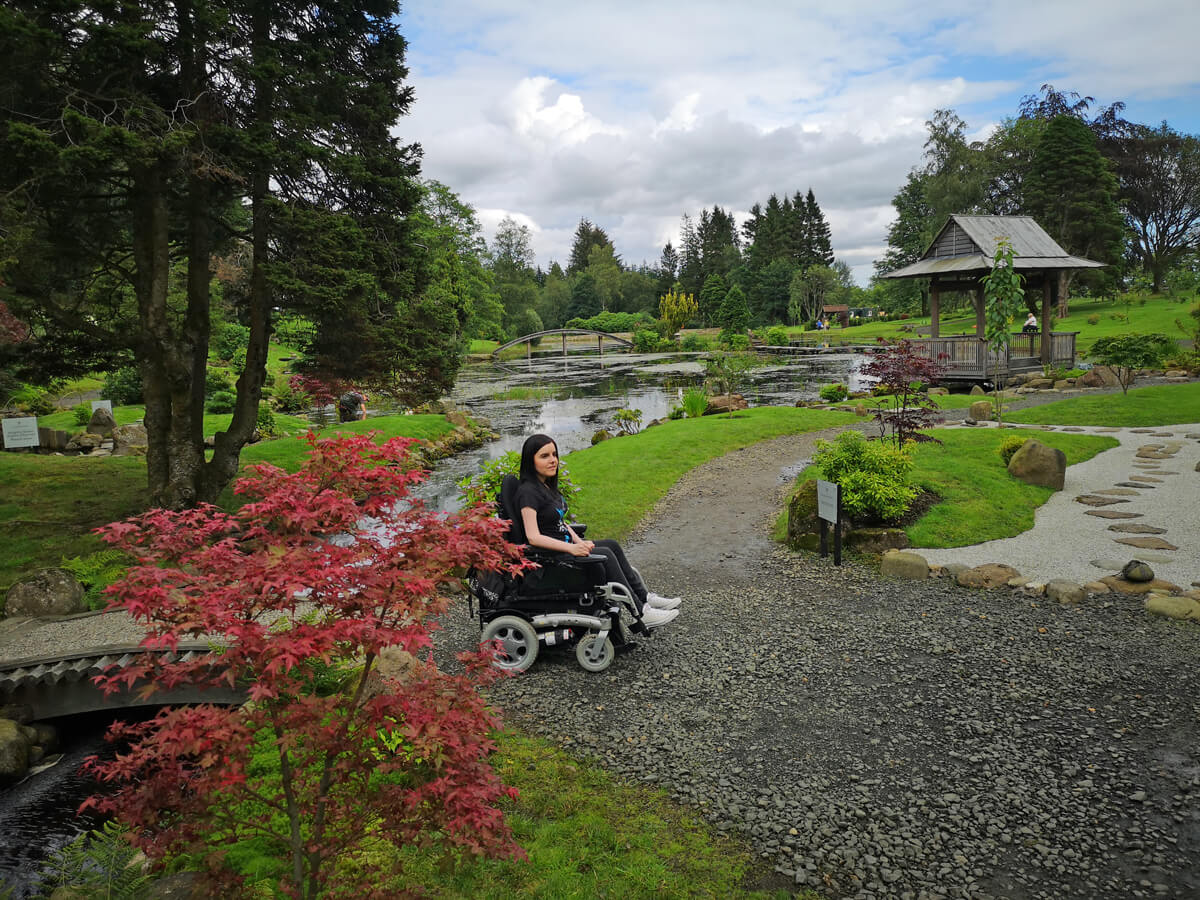 Emma driving across gravel paths in the Japanese Garden at Cowden.