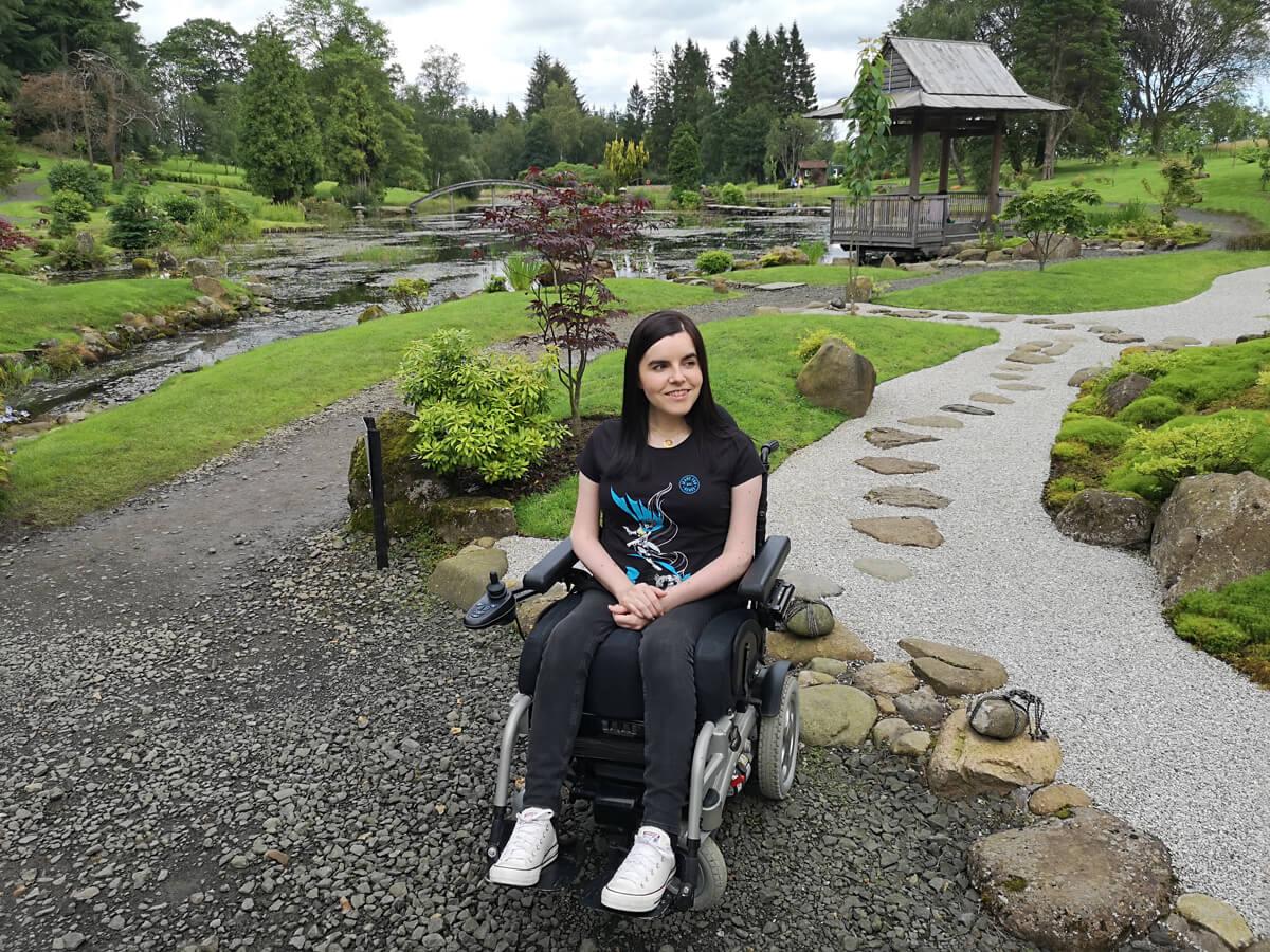 Emma sitting in her wheelchair in the Japanese Garden.