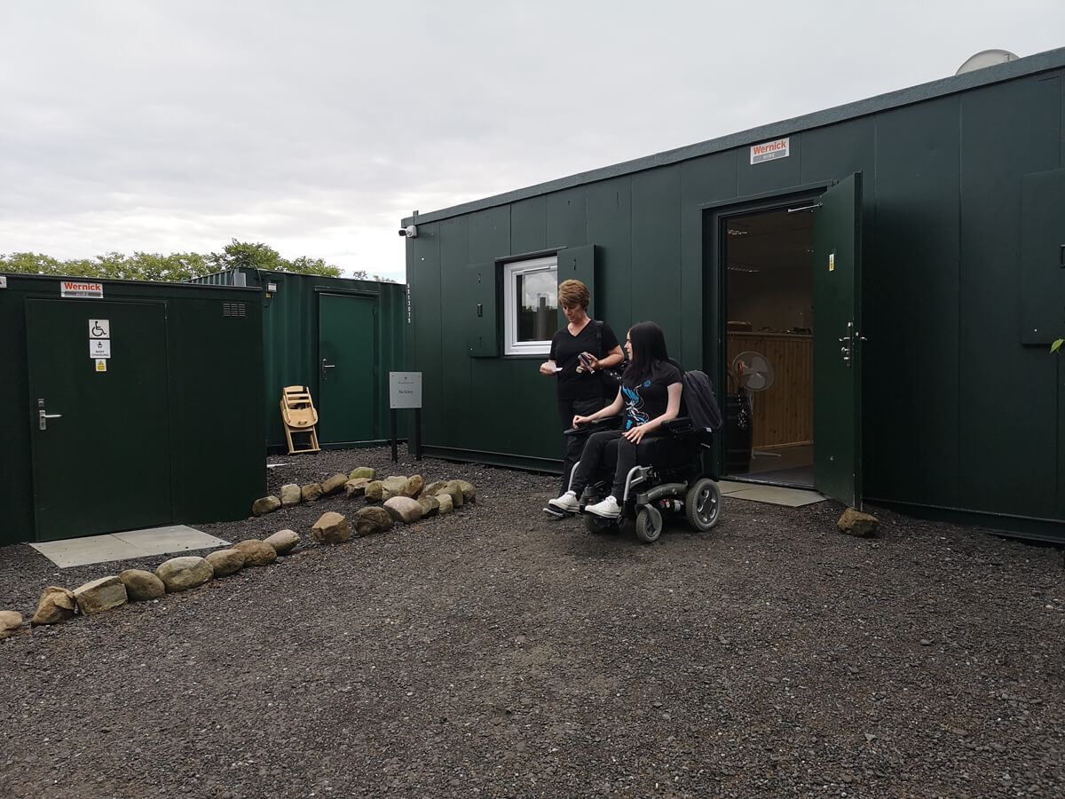 Emma and her Mum coming out of the ticket office at Japanese Garden at Cowden.
