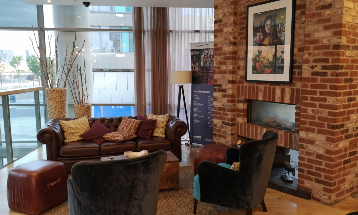 The lounge area with sofas, armchairs and lamps. This area has a view out onto the dock.