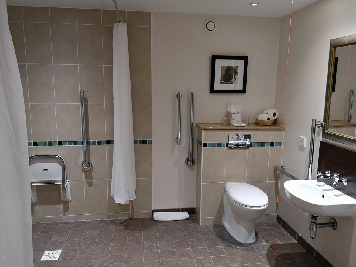 The wheelchair accessible bathroom.