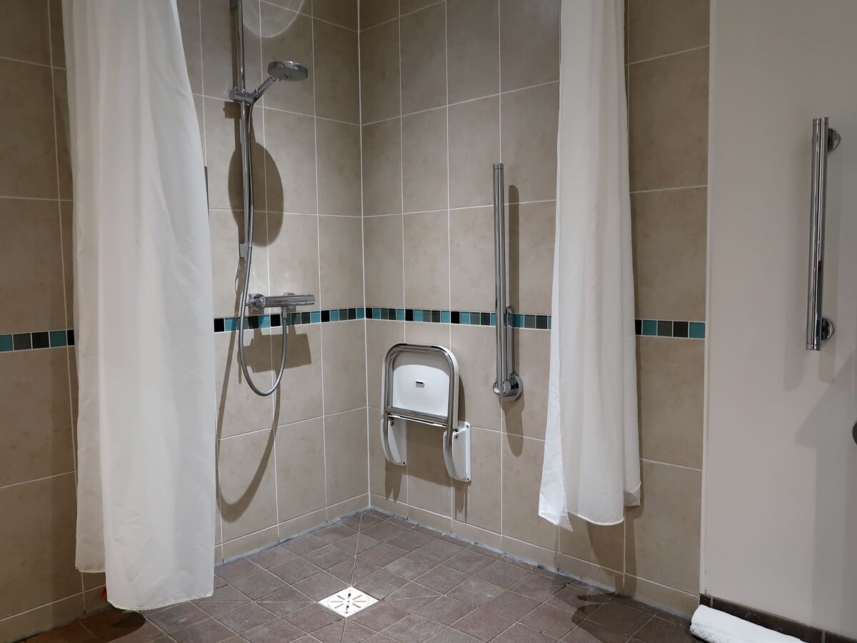 The roll-in shower in the wheelchair accessible bathroom.