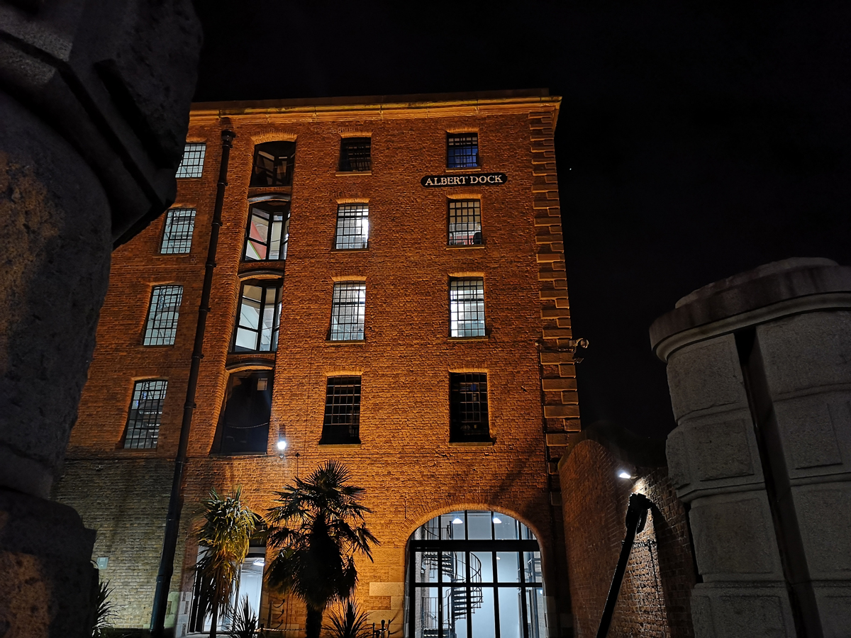 A shot of a building in Albert Dock at night.