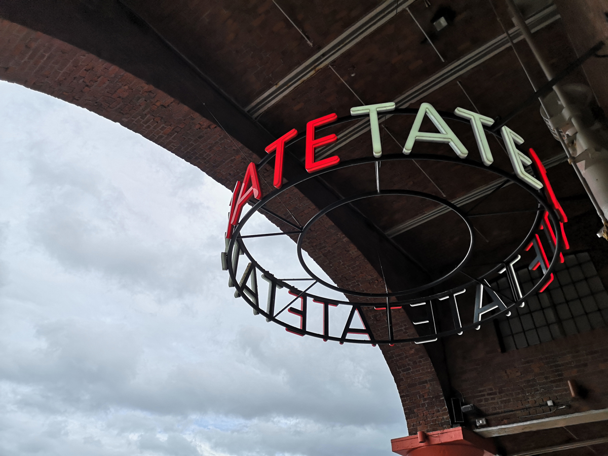 Tate Liverpool sign in red and white font.