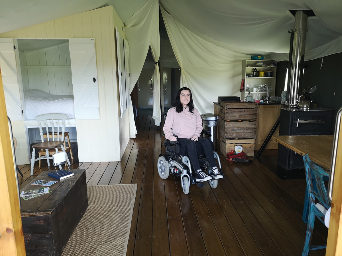 Emma inside the wheelchair accessible safari tent