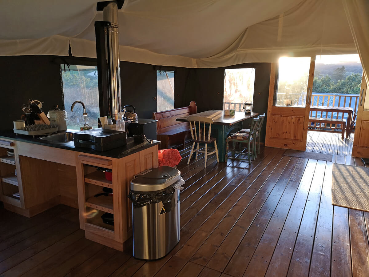 The kitchen and dining area in the accessible safari tent.