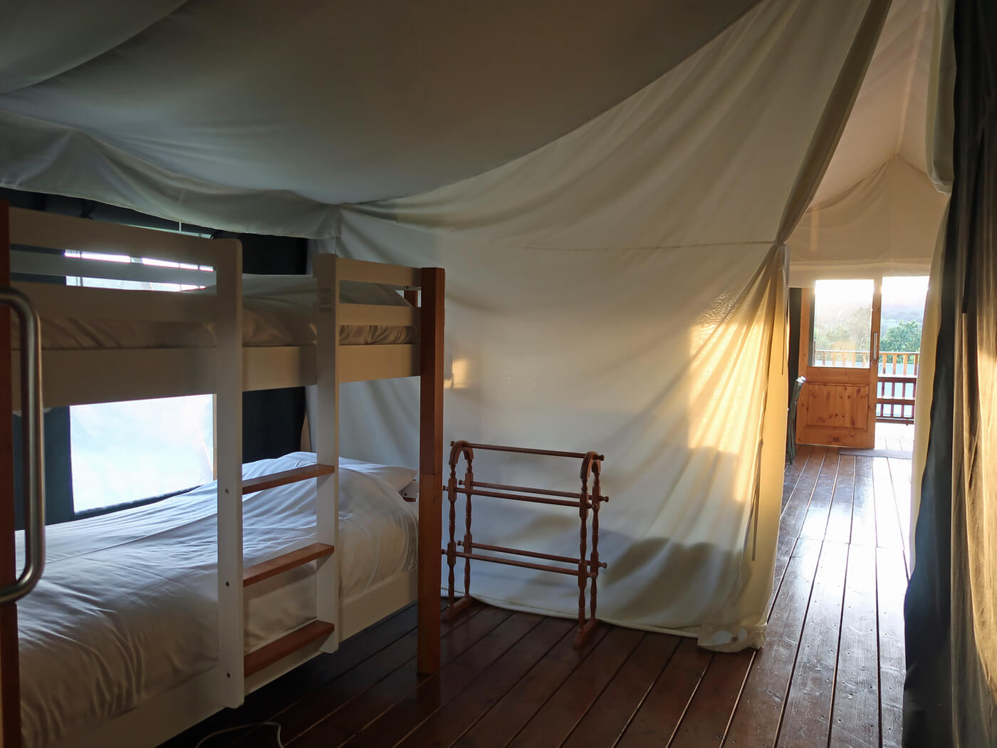 Twin bunk beds in safari tent at Canvas and Campfires.