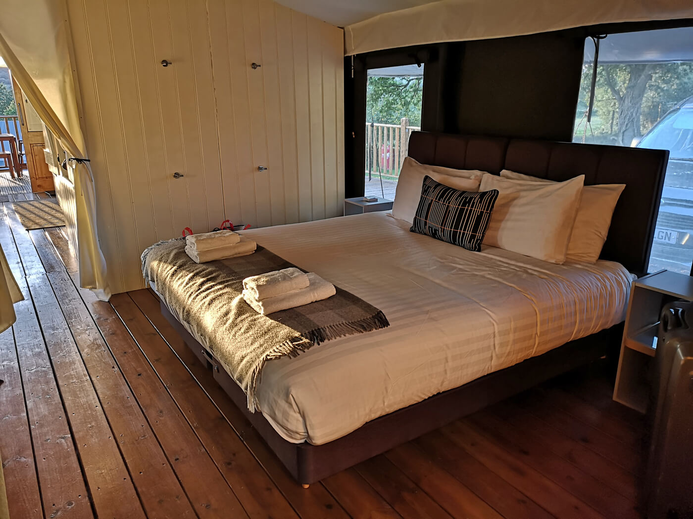 Super king bedroom in safari tent at Canvas and Campfires