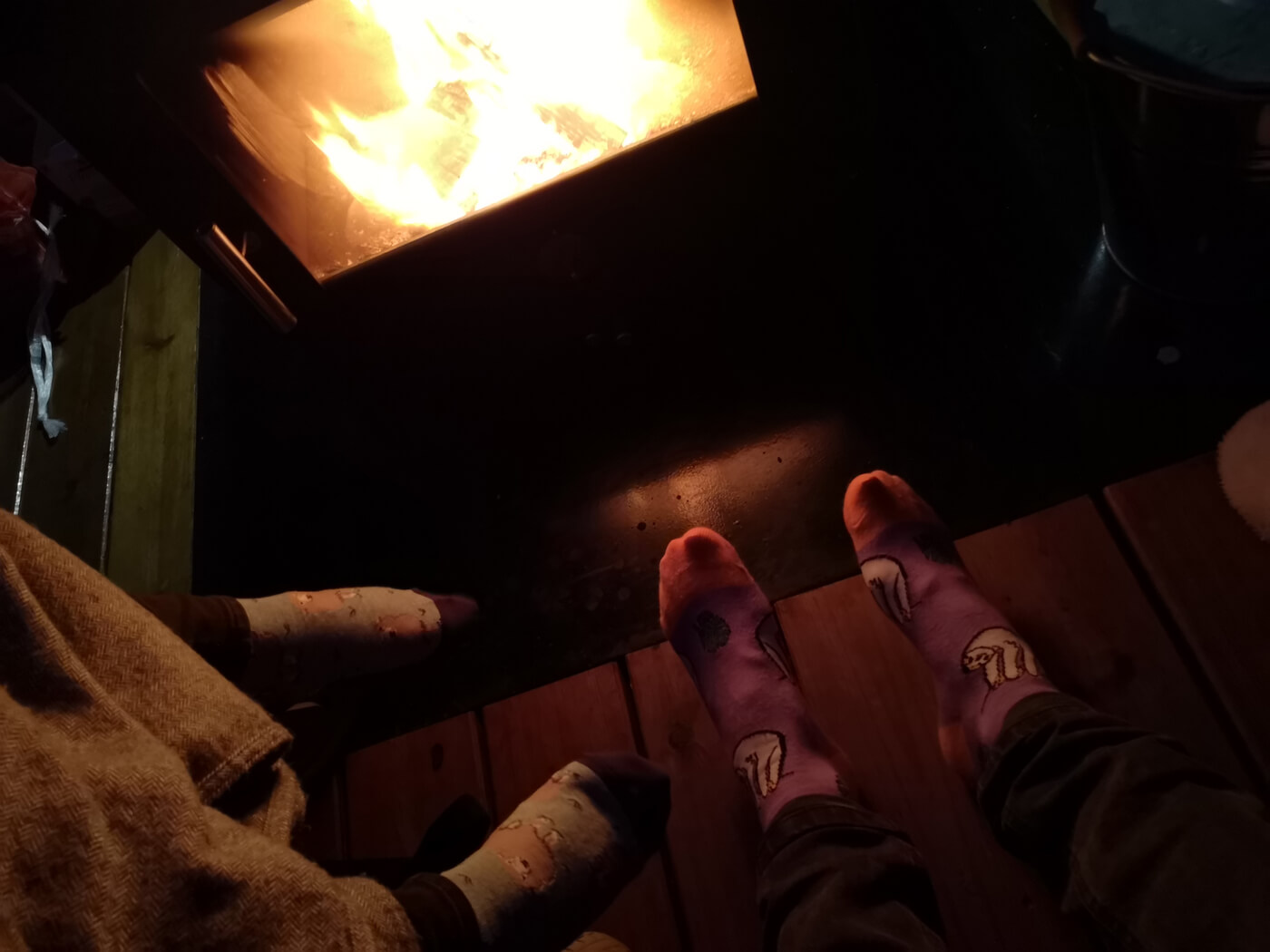 Emma and Allans feet next to the log fire.