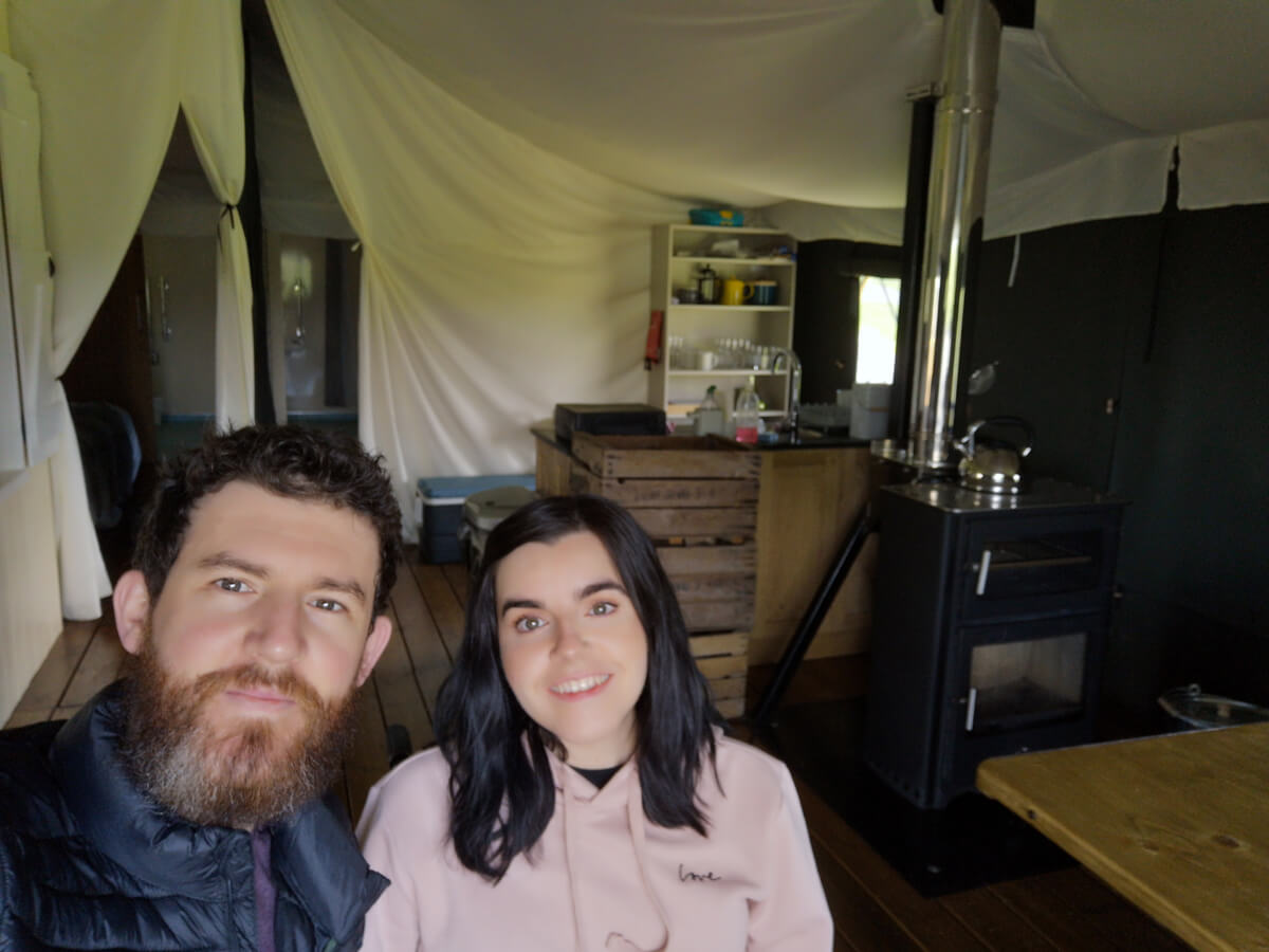 Emma and Allan taking a selfie inside the tent.
