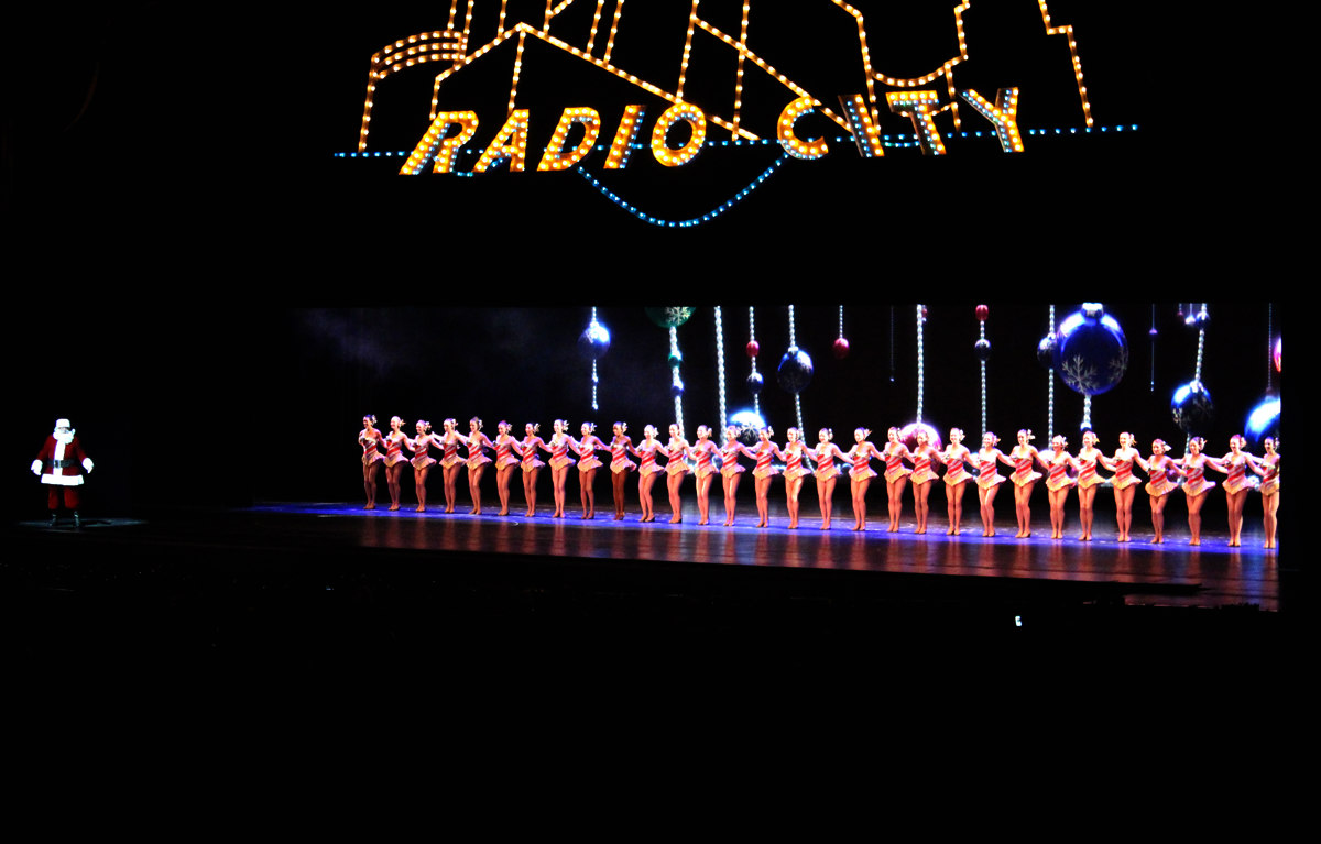 The Rockette's dancing on the stage at Radio City's Christmas Spectacular.