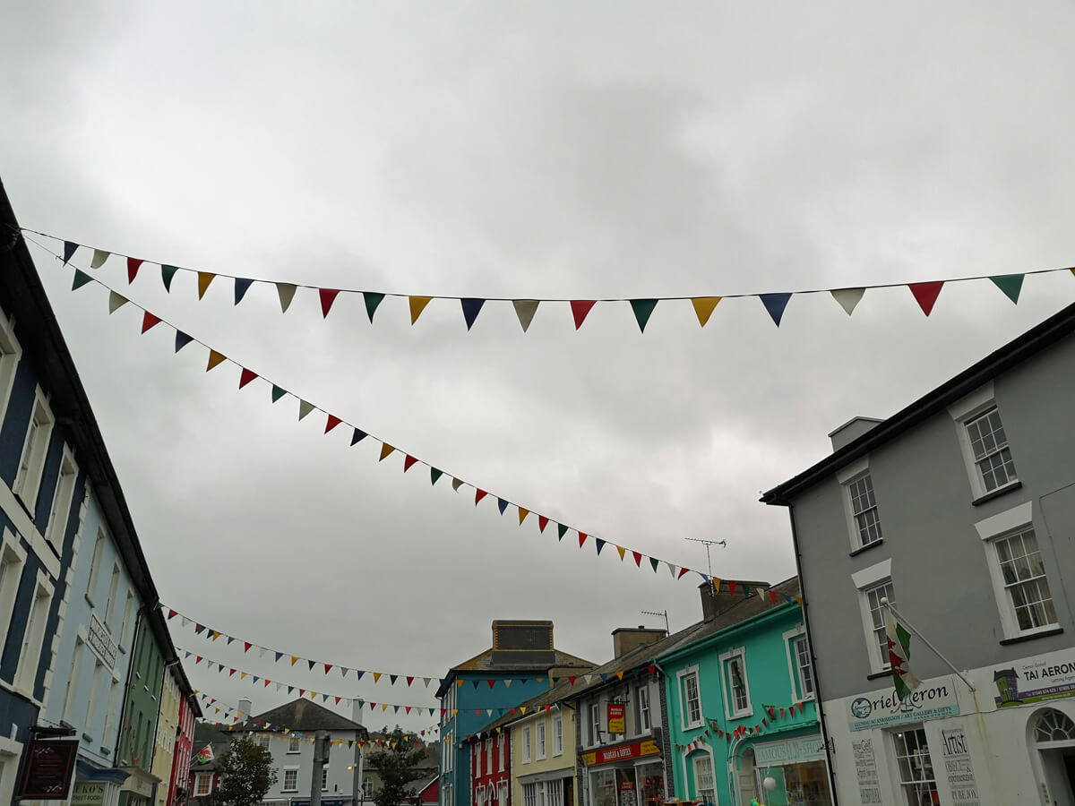 Flags hanging across a street in Aberaeron town