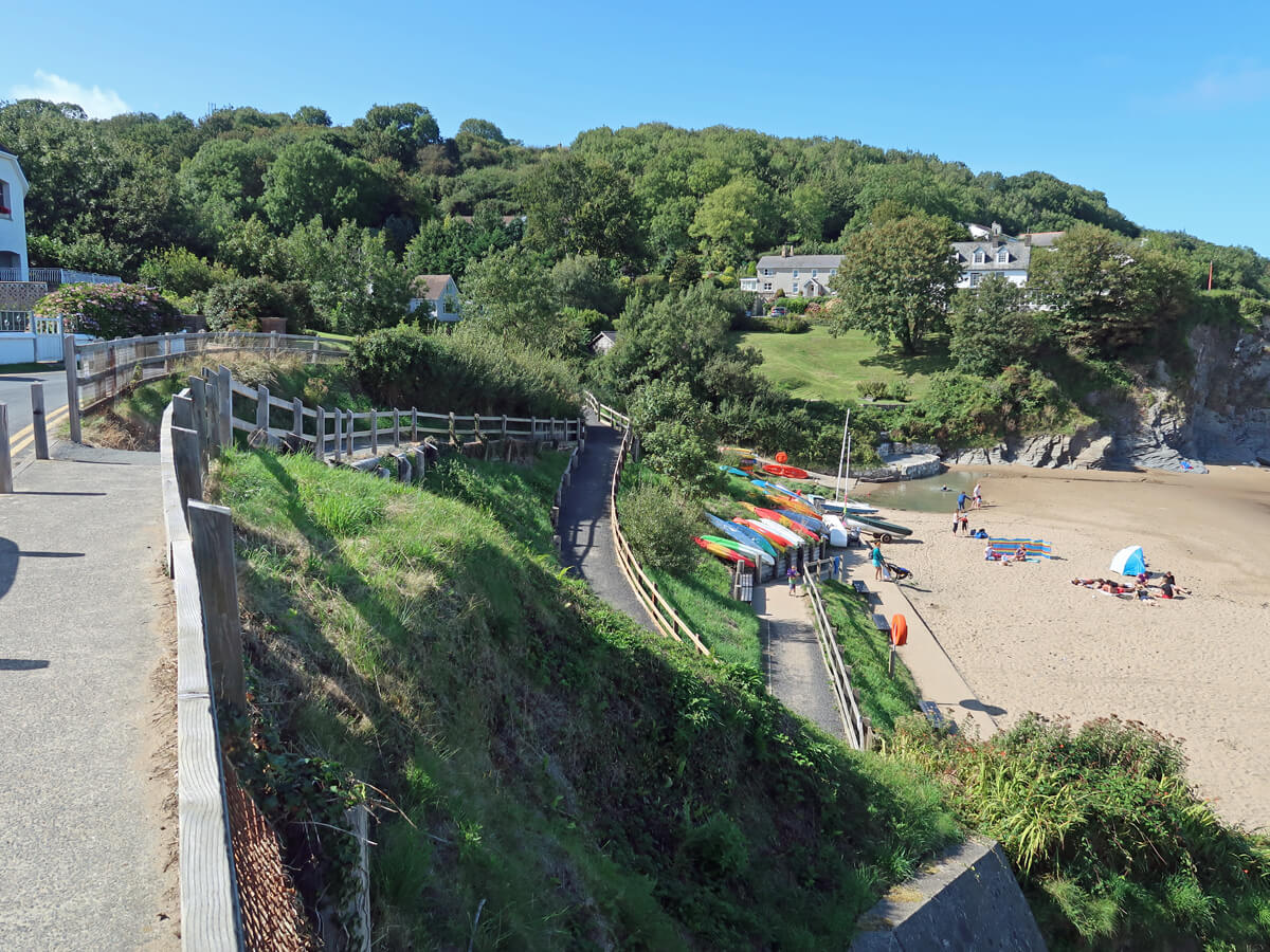 An overview of Aberporth Beach showing the long windy ramp down to the beach.