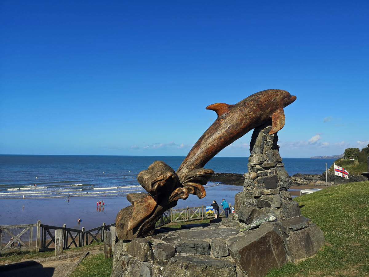 Aberporth Beach wooden carved dolphin.
