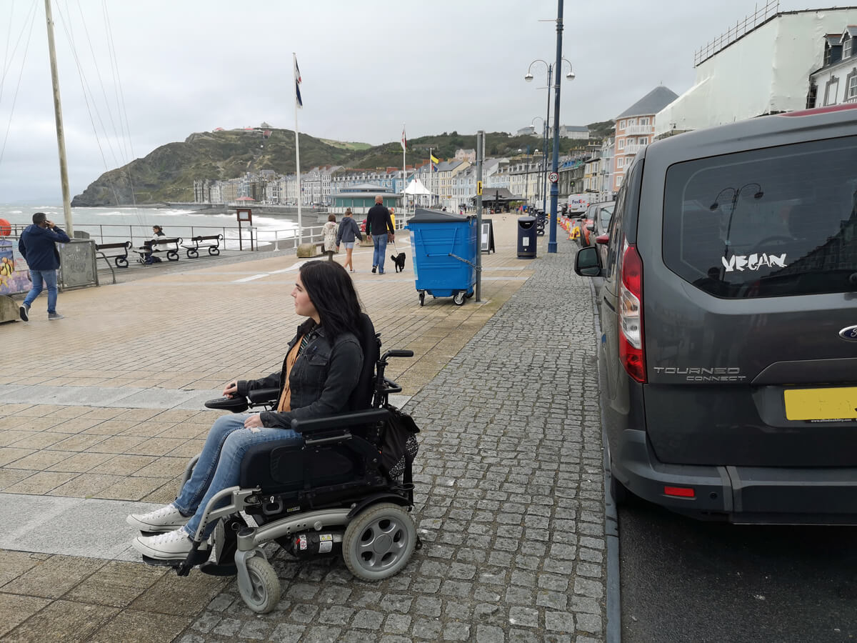 Emma's wheelchair accessible car parked next to the pier and promenade in Aberystwyth