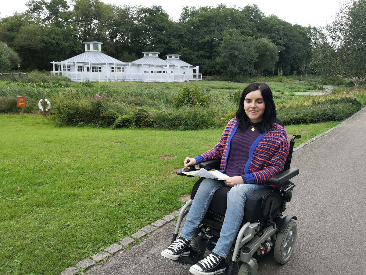 Emma driving her wheelchair across the wide paths at National Botanic Garden of Wales