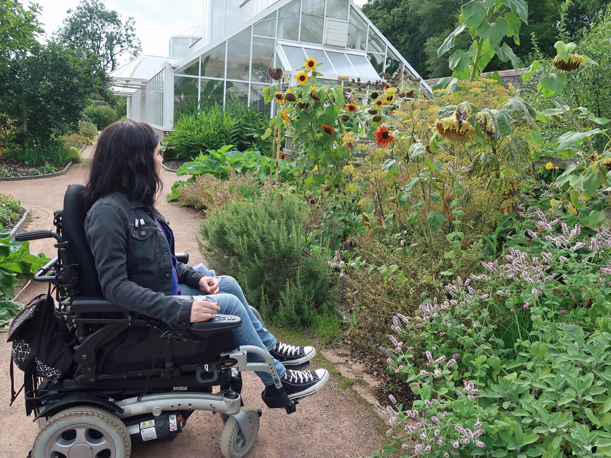Emma admiring the flowers at National Botanic Garden of Wales
