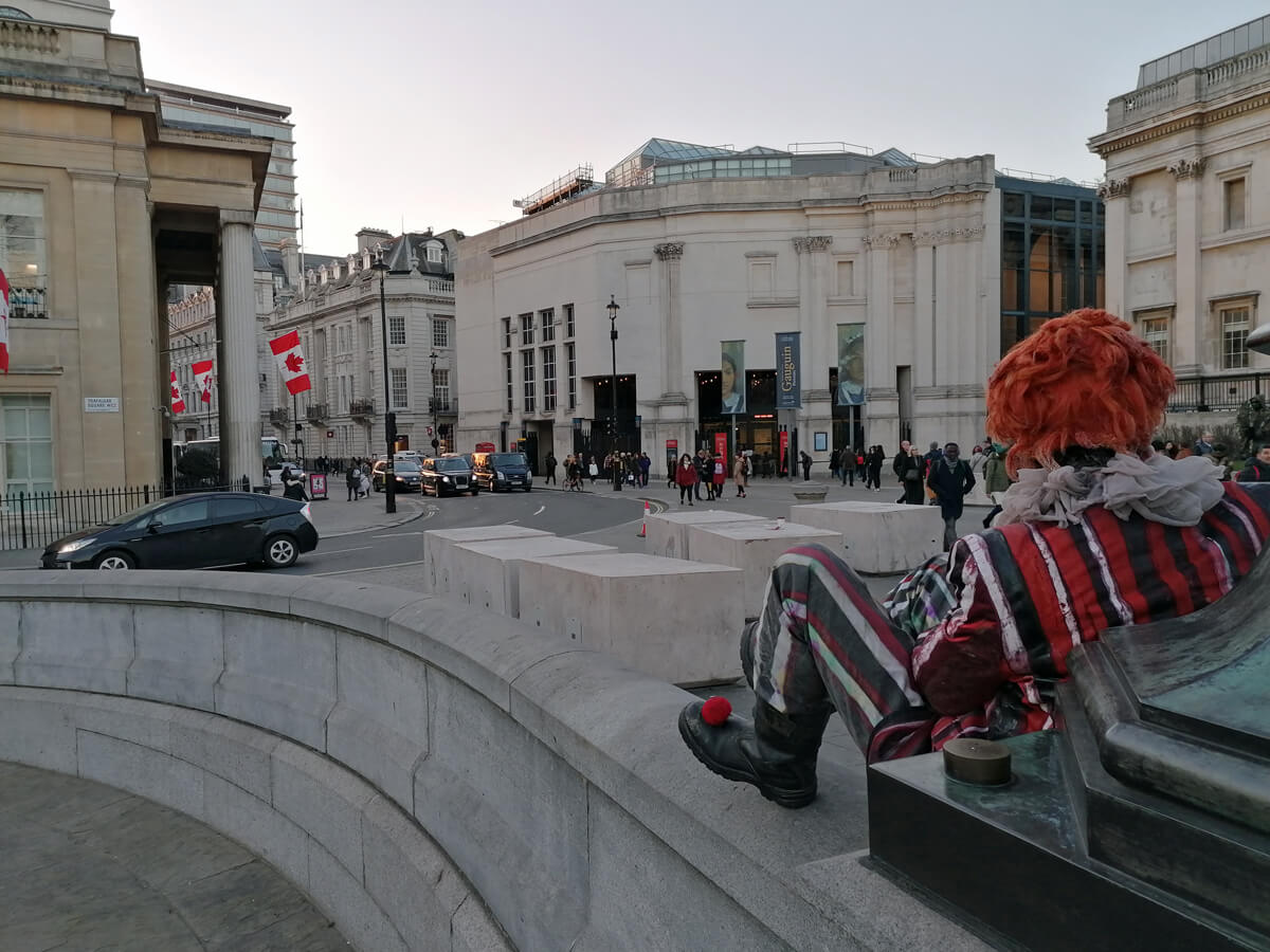 A man dressed up as Pennywise from IT in Trafalgar Square