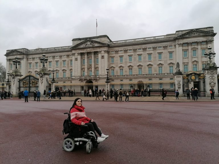 Emma posing outside Buckingham Palace