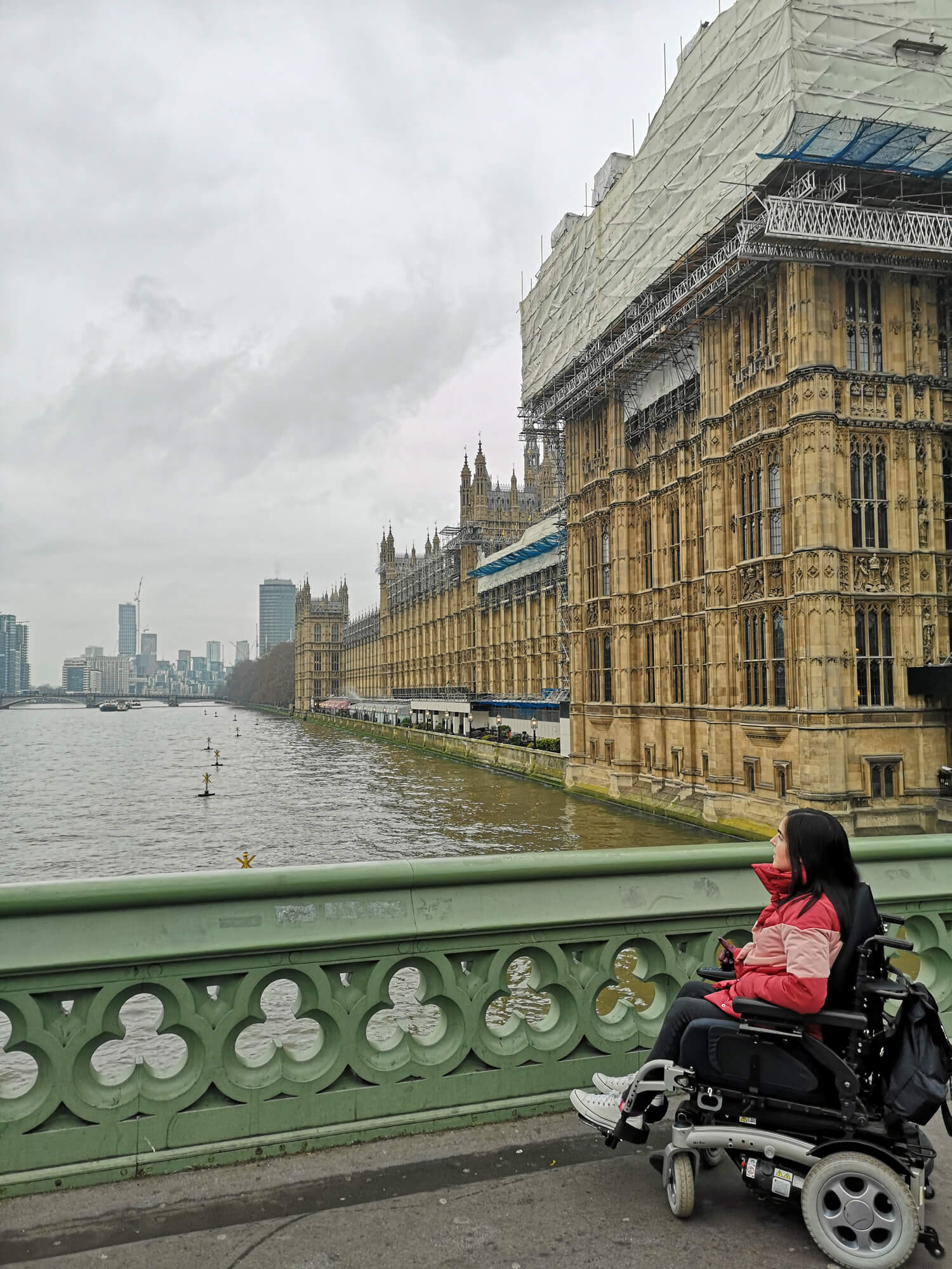 Emma looking over Westminister Bridge with Westminister behind her.