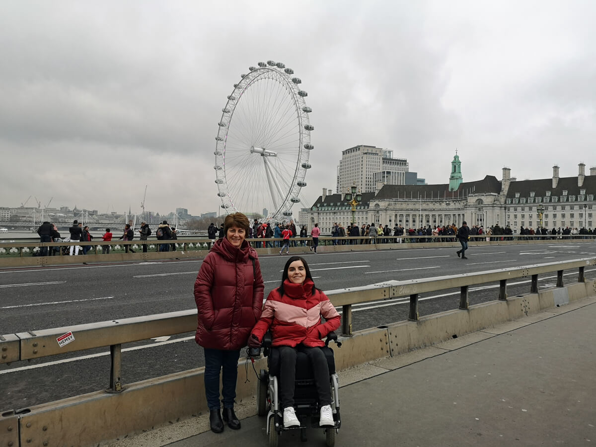 Emma and her mum on Westminister Bridge with the London Eye behind them.