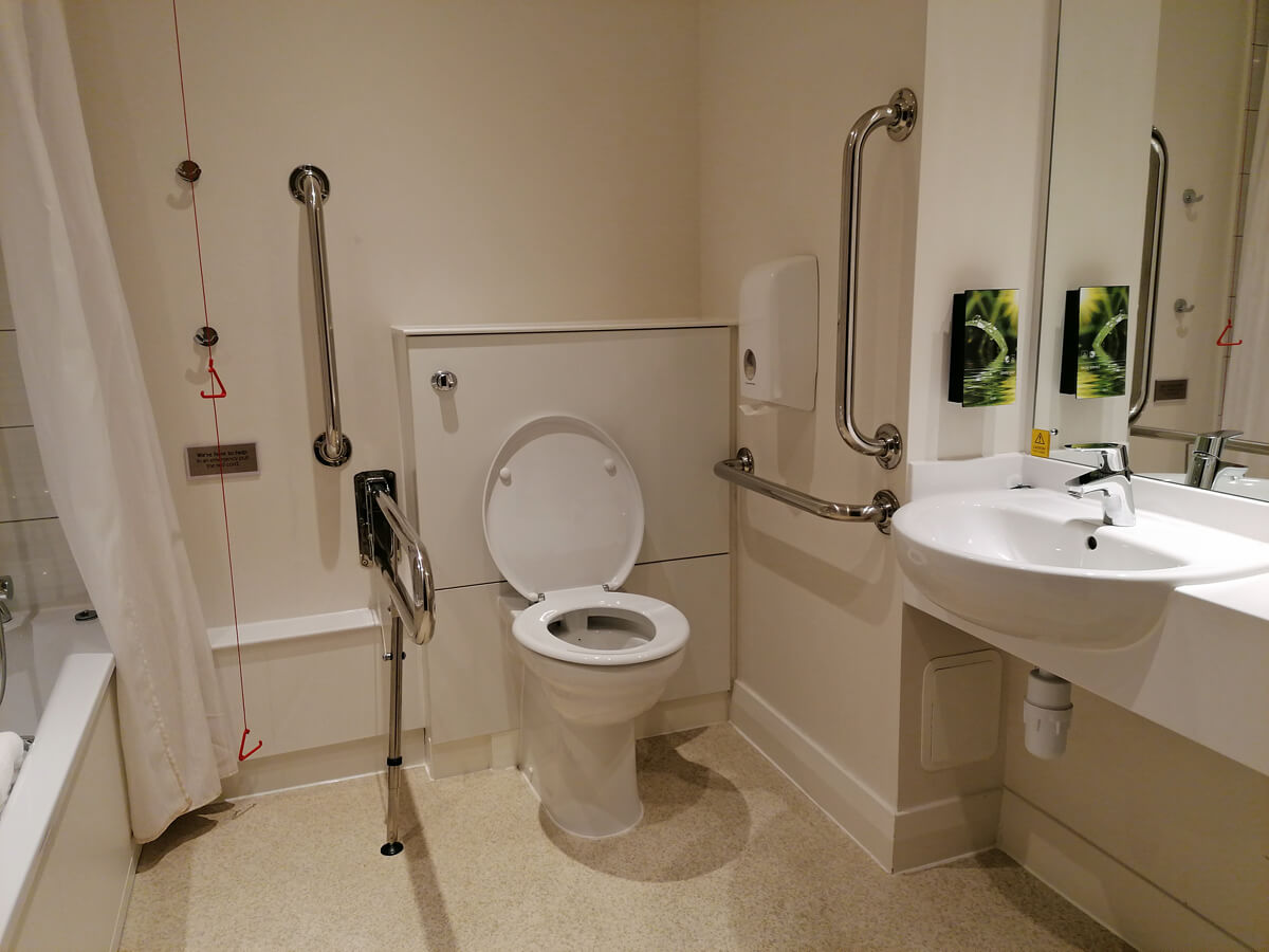 The toilet and sink in the accessible bathroom.