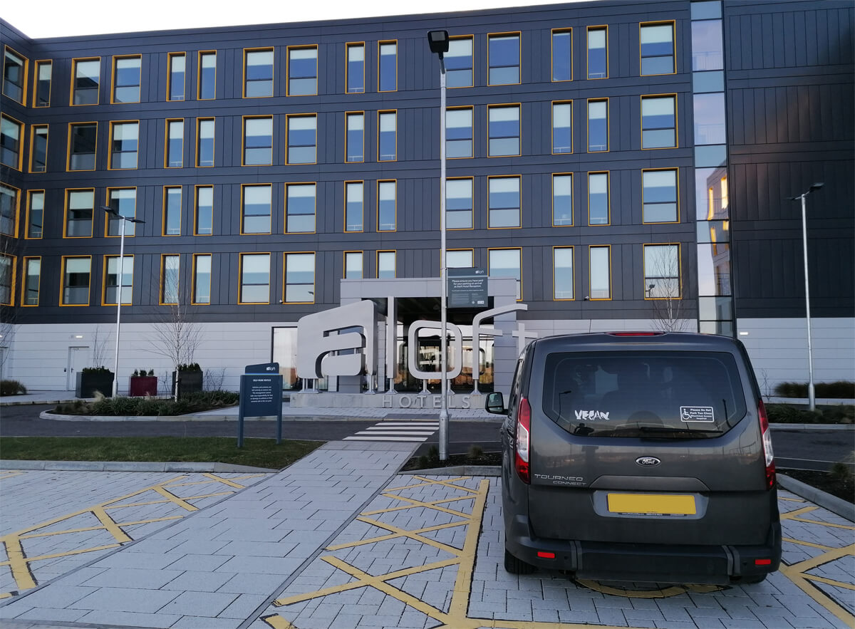 A view of the hotel from the disabled parking bay. Emma's wheelchair accessible vehicle is parked in the bay.