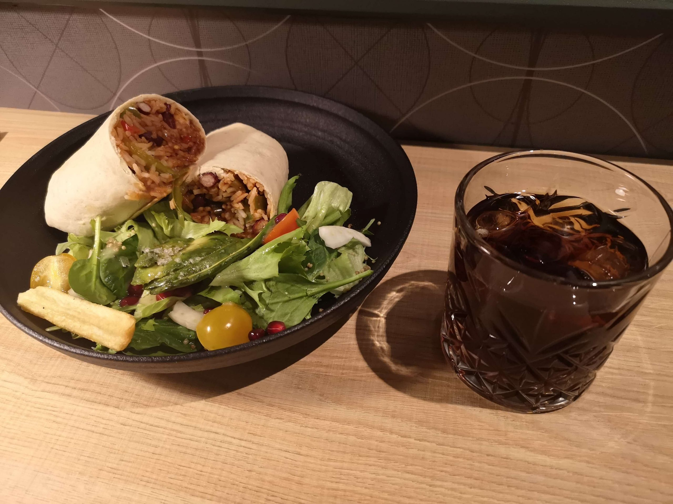 A vegan burrito at a glass of coke at Aloft Aberdeen TECA.