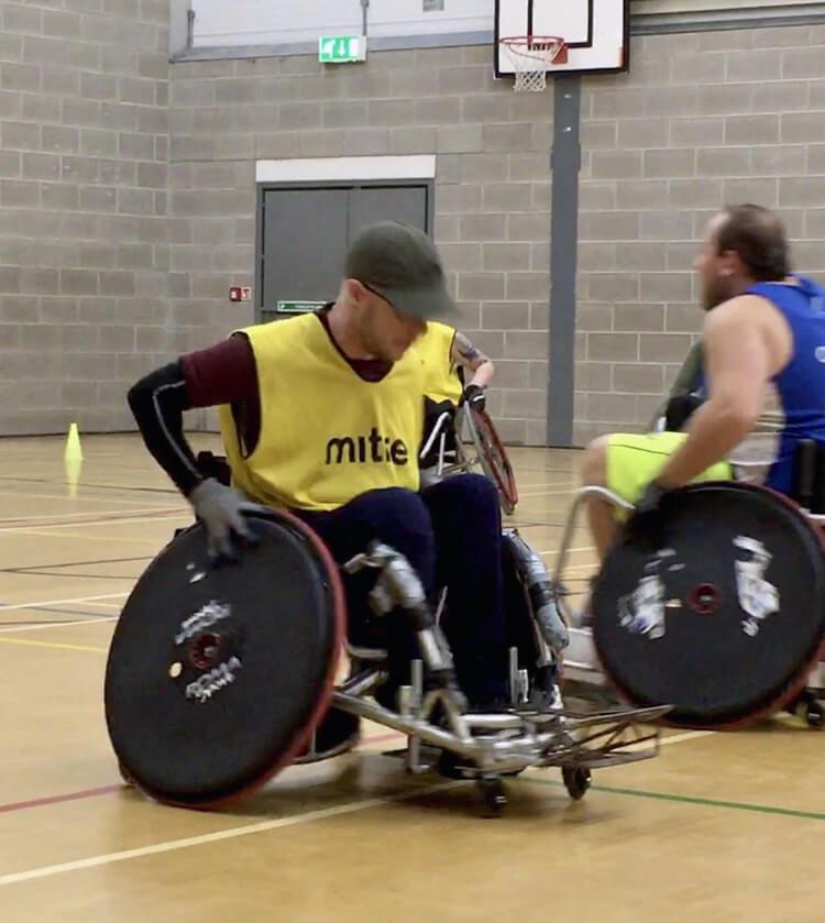Ben playing wheelchair basketball.